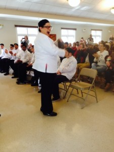 Image of a Community Culinary School graduate receiving her diploma and ServSafe Certification