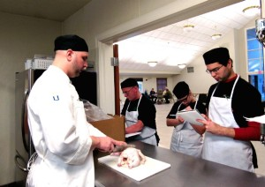 Community Culinary School Chef Instructor, Justin Elander teaches students how to breakdown a chicken.